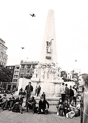 Amsterdam (kirstiecat) Tags: amsterdam netherlands strangers people monument statue tourists birds flight flying canon architecture disconnected headphones damsquare street dutch monochrome monochromemonday blackandwhite young youth nationalmonument philosophy peace war worldwarii wwii poem sculpture jjpoud