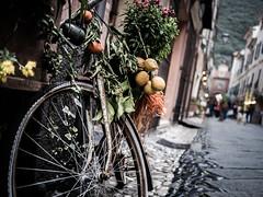 Finalborgo (arsamie) Tags: finalborgo street bike italy fruits green vegetables market rusty wheel bokeh north perspective orange lemon