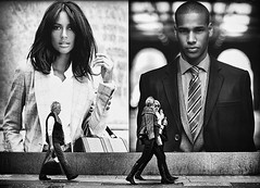 street watchers (White_V) Tags: street girls woman london girl sunglasses wall walking poster women models suit handbag oxfordstreet whiteandblack streetwatchers