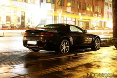 In the rain... (ND | Automotive Photography) Tags: auto light black cars wet car rain photography stream nightshot martin cologne convertible automotive kln rainy nd raindrops streams autos v8 aston spotting raindrop vantage roadster lightstreams shmee carspotting worldcars v8v shmeemobile