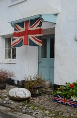 Old flag and front door (Ianto73) Tags: door summer england rural countryside nikon britain jubilee flag entrance coastal devon dslr unionjack slapton 2012 bunting southdevon d3100