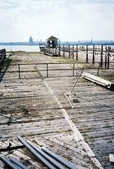 docks (steve marland) Tags: wood uk england urban streets film architecture liverpool docks river pier decay mersey olympusxa 2012