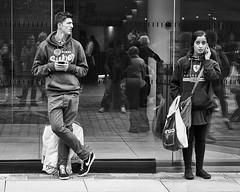 Watching Her, Watching Me (Explore - 30 June 2012 - #452) (Peter.Bartlett) Tags: street city people urban blackandwhite woman man girl monochrome mobile pen manchester mono blackwhite phone candid streetphotography olympus mobilephone nik olympuspen ep3 explored streetphotographyurban niksilverefex microfourthirds