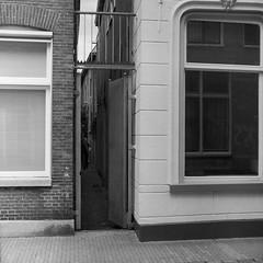 Zeijlsgang (Alex !) Tags: red white black streets 120 film monochrome analog mono gang filter hp5 groningen 88 r2 kiev ilford steegje visserstraat binnenstad gangen steegjes zeijlsgang zijlsgang
