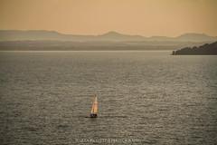 Lake sunsets (Martolda) Tags: sunset lake trasimeno lago tramonto canon7d sky water vela sailing boat