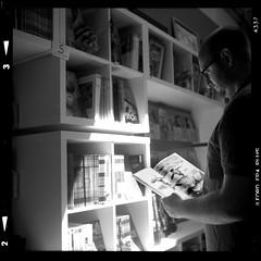 Ben at the Comic Shop 16081902 (jimhairphoto) Tags: ben read comic books portland oregon america nw northwest leftcoast remainsoftheday naturalworld rolleiflex tlr 35automat k4a manufacturedin1953 twinlens rollei 120mm film 120film ilford fp4 blackandwhite blancetnoir schwarzeaufweis blancoynegro blancinegre siyahrebeyaz jimhairphoto