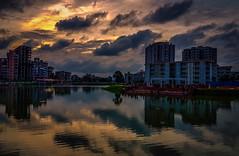 City Sunset .... (mithila909) Tags: landscape lake cloud reflection building evening eveningsunset dhaka bangladesh