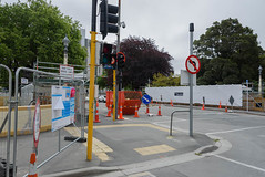 Which Way Con You Go? (Jocey K) Tags: newzealand christchurch architecture building cbd roadcones oxfordterrace bridge fence signs road street skip bin trees tree sky clouds