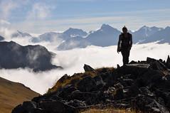 Hiking above the clouds. Chugach State Park, Alaska (Paxson Woelber) Tags: alaska mountains landscape chugachmountains chugachstatepark alaskahikes alaskahiking alaskalandscape alaskascenery abovetheclouds climbingaboveclouds hikingaboveclouds mountainhikes mountainhiking hiking hikes paxsonwoelber joshlofgreen hiker hike backcountry backcountryhiking backcountryhiker silhouette hikersilhouette ak