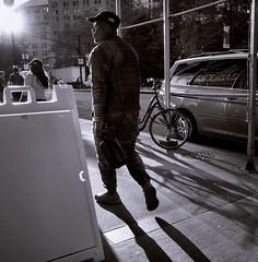 (Rather subdued) Rush Hour Transport, Park Row (sjnnyny) Tags: parkrow cityhallparknyc tonemonochrome cropped streetphtomanhattan walking nyc ricohgrii sunset sidewalk sideillumination figure stevenj sjnnyny apsccompact