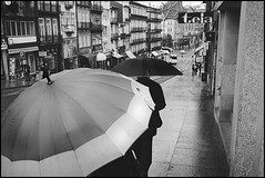 Fado XIX: So withdrawn (The 3rd umbrella) (Sator Arepo) Tags: leica urban blackandwhite classic portugal rain weather umbrella 35mm vintage vanishingpoint streetphotography rangefinder porto walker rainy summilux oporto encounter m9 preasph leicam9 retofez120703