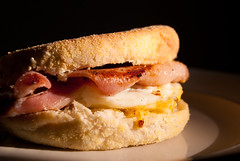 Bacon and Egg Muffin (Kokkai Ng) Tags: food sunlight english blackbackground breakfast bread table cuisine bacon focus burger egg sydney australian plate australia nobody mcdonalds pork american meal newsouthwales copyspace cooked muffin homecooked fried selective maccas foodsanddrinks differentialfocus