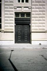 Door (12th St David) Tags: door nyc shadow newyork film 35mm manhattan slide financialdistrict lamppost e6 olympusxa fujivelvia50 policemuseum olympusfzuiko35mmf28