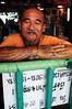 Smiling ferryman (5ERG10) Tags: portrait orange holiday man green smile sergio tattoo ferry writing river beard thailand lights nikon asia head bangkok tailandia palace tattoos ring moustache nails bracelet nikkor simple thep d300 28300 tattooed krung กรุงเทพมหานคร สยามพารากอน amiti 5erg10 facethai mahaaprilbangkokgrand