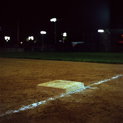 Untitled (Owen Luther) Tags: 6x6 film grass night analog mediumformat dark square lights chalk kodak bokeh hasselblad dirt 100 infield baseballfield ektar cablerelease firstbase hasselblad500cm
