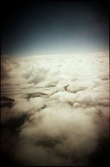 wingtip cloudscape (mugley) Tags: travel sky colour film window clouds plane 35mm airplane flying kodak horizon transport flight wing australia wideangle aeroplane aerial scan crappycam negative epson 135 vignetting planewindow c41 22mm v700 kodakgold400 gold400 vivitarultrawideandslim wideslim eximus eximuswideandslim