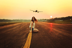 Young and restless (Gabriella Corrado) Tags: sun plane airplane 50mm golden airport f14 young teenagers windy cannon goldenhour sunet reckless invincable gabriellacorrado lookingforalaka