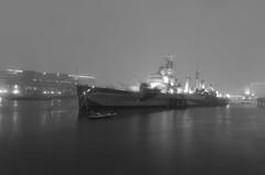 The Eerie Lights of HMS Belfast (Torsten Reimer) Tags: uk longexposure bridge light england blackandwhite snow london water museum night towerbridge river boat ship nacht unitedkingdom eerie guns turret cruiser warship royalnavy kriegsschiff hmsbelfastc35