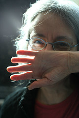 Susan © (Blackcatatheart) Tags: light portrait mouth hair grey glasses airport cover age wrist gesture wrinkles
