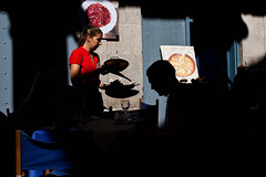 Sun and shadow and red, and blue and paella (javiermartinphoto) Tags: barcelona street urban streetphotography tourists streetphoto boqueria javiermartinphotocom peoplewhoneveryawn