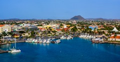 Landscape Aruba. (ost_jean) Tags: landschap aruba caribbean ostjean boats water houses blue ngc