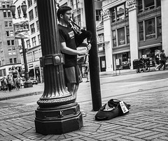 The Piper (TMimages PDX) Tags: iphoneography photography image photo photograph streetscene fineartphotography geotagged people urban city street streetphotography portland pacificnorthwest sidewalk pedestrians buildings avenue road blackandwhite monochrome vignette musician bagpipes instrument entertainer
