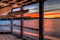 Sunset La Perouse Sydney (600tom) Tags: sunset cloud streaks boats kyacks timber frame silhouettes reflections colourful australia botany bay sand