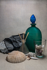 Still life with a green bottle (Alexander Pugatschewski) Tags: stil llife green bottle sinks background fabric texture structure shell snail scallop shadow light bunch grape coarse glass mat shank scarf color fringe vase wood stick