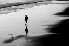 Untitled (blueteeth) Tags: man cowboyhat bird beach shore wetsand reflections silhouettes highkey monochrome blackandwhitebw