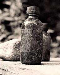 Tincture (Professor Bop) Tags: professorbop drjazz olympuse5 stilllife bottle monochrome blackandwhite bw