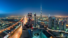 The Veins of Dubai #11 (DanielKHC) Tags: blue roof night digital bay haze nikon dubai top uae business khalifa hour dri hdr burj blending d300 danielcheong nikkorfisheye105mmf28 danielkhc