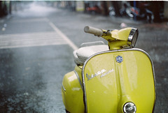 Yellow Vespa in the Rain