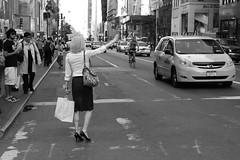 The art of Hailing a Cab (Olderhvit) Tags: street new york nyc bw woman ny newyork black monochrome hail canon photography foto cab taxi streetshots streetphotography 7d petri stad fotografi vitt svart 24105 gatubilder img9023 gatufoto gatufotografi newyorkphotography nycphotography olderhvit