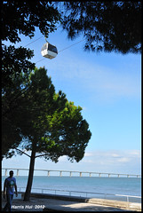 Cable Car in Parque das Naes - Lisbon N9945e (Harris Hui (in search of light)) Tags: travel vacation canada portugal vancouver walking nikon europe bc lisboa lisbon richmond cablecar parquedasnaes pontevascodagama timing d300 themoment travelphotography vacationtravel tejoriver rivertagus nikon18200mmvr nikonuser nikond300 harrishui vancouverdslrshooter
