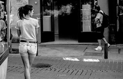smoking girl (pukilin) Tags: madrid street city people bw girl 35mm calle chica cigarette candid smoke ciudad bn smoking randompeople humo cigarro fumando robado nikond3100