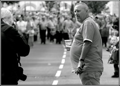 Considerate (* RICHARD M (Over 5 million views)) Tags: candid mono blackwhite considerate orangemensday thetwelfth 12thjuly ray g8lite flickrites togs photographers crowds street pintglass southport sefton merseyside beerbelly band marchingband marches marchers