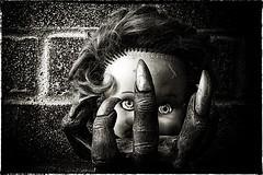 Hold your Head up (Evoljo) Tags: doll sinister creepy hand head wall brick eyes nails plastic nikon d500 hair toy