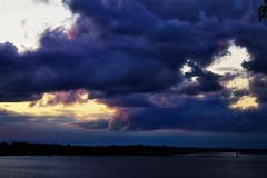 Storm clouds over Presque Isle (i saw the Sign) Tags: lighthouse stormclouds presqueisle lakeerie erie pennsylvania skyscape landscape sunset presqueislebay harbor
