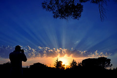 The Photographer and Sunset (natureloving) Tags: sunset nature rays silhouettes natureloving nikon d90