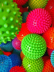 Spiky (Thad Zajdowicz) Tags: ball spike bright vivid vibrant color green pink blue colour indoor inside toys abstract pasadena california zajdowicz cellphone aviary motorola droid turbo smartphone cameraphone android mobile 366 365