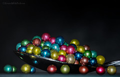 sugar drages (sure2talk) Tags: macromondays sweetspotsquared nikond7000 nikkor85mmf35gafsedvrmicro sugardrages sugarballs drages multicoloured metallic shine flash speedlight sb900 offcamera diffused softbox colours sweet