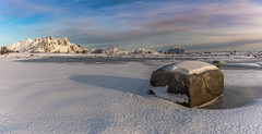 Caught Between a Rock & a Cold Place (Jerry Fryer) Tags: ballstad lofoten norway arctic snow covered mountains ice frozenbeach lateafternoon longshadows landscape clouds white beach sea