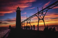 Sunset From the Pier - Grand Haven, Michigan (kweaver2) Tags: kathyweaver photography lighthouse lightstation landscape michigan lake greatlakes fineartphotography art sky clouds grandhaven pier sunset people
