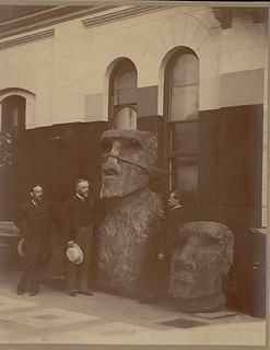 George Brown Goode, Samuel D. Langley, and Otis T. Mason with Two Moai (Lava Stone Effigy Figures) Inside Museum Building n.d.