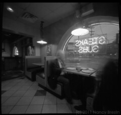 Pizza in Newark, Delaware (squaremeals) Tags: bw restaurant mainstreet neon seasons pizza delaware newark pinholephotography squaremeals