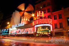Moulin Rouge (peterotoole) Tags: show longexposure windows light sunset red summer sculpture orange blur paris france cars apple lamp windmill car tarmac metal night clouds photoshop dark awning graffiti movement mac pub aperture nikon europe neon raw traffic dynamic dancing zoom spin tripod  warmth headlights tourists iso peter nighttime signage processing handheld fencing editing lighttrails panels railing moulinrouge dslr burlesque range edit businesses flicker slowshutterspeed rotate otoole starbust bfv1 flickraward d7k roseawards awardflickrbest d7000 nikond7000 peterotoole