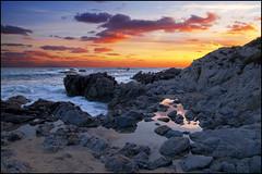 ...on the rocks... (zio paperino) Tags: sunset sea sky italy mer beach nature clouds puddle mar nikon rocks italia tramonto mare playa natura vaticano cielo puesta capo calabria tropea d90 ricadi ziopaperino mygearandme