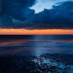 Unshore (AndWhyNot) Tags: blue sunset orange cloud seascape reflection skyscape coast kent twilight shoreline whitstable 9658