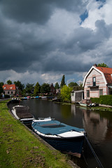 Along Gein river @ Abcoude (PaulHoo) Tags: abcoude holland netherlands contrast 2016 nikon d700 summer gein river clouds sky cityscape city urban boat reflection sun water