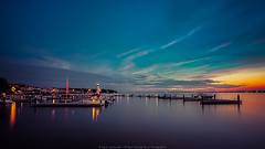 Turquoise Skies (Rajesh Jyothiswaran) Tags: turquoise sky skies harbor harbour rockwall lake light lighthouse water clouds boats reflection shoreline dallas texas sunset landscape colorful mediterranean